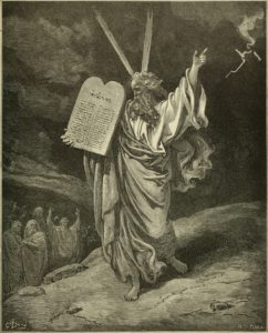 Engraving of Moses holding the Ten Commandments.