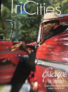 Magazine cover with headline, Escape the Ordinary